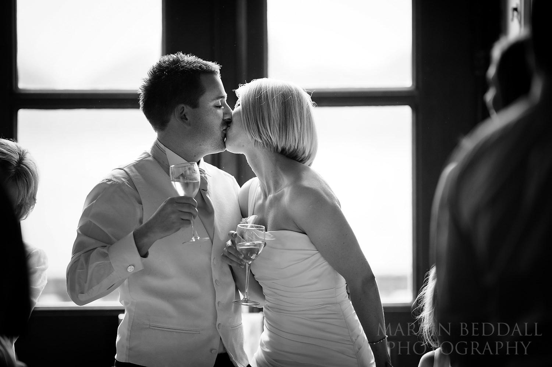 Bride and groom kiss at Kirtlington Park wedding