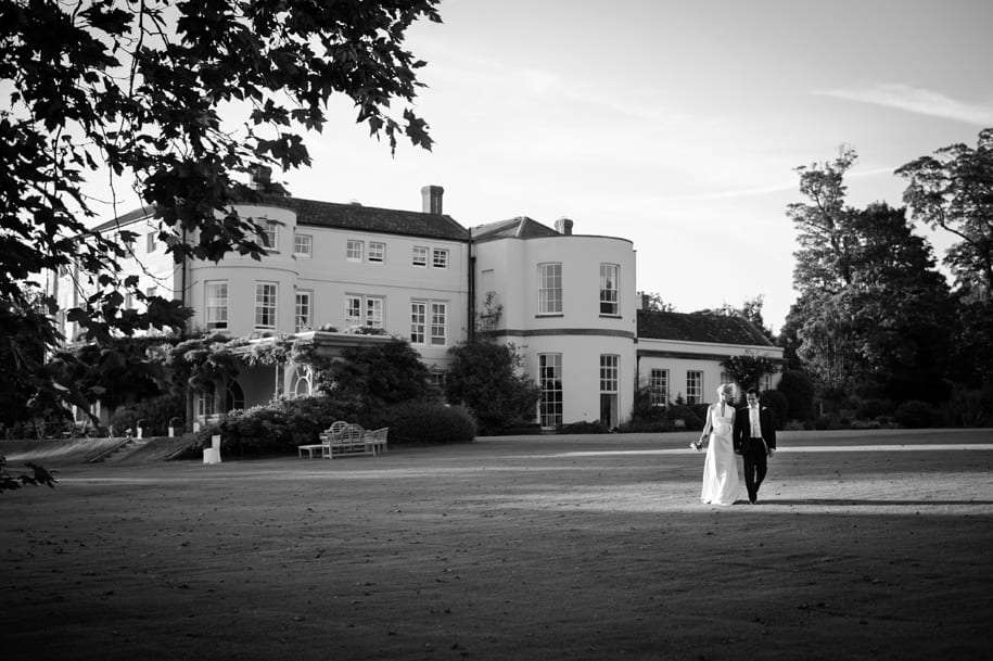 Bride and groom in the evening summer sun at Newick Park