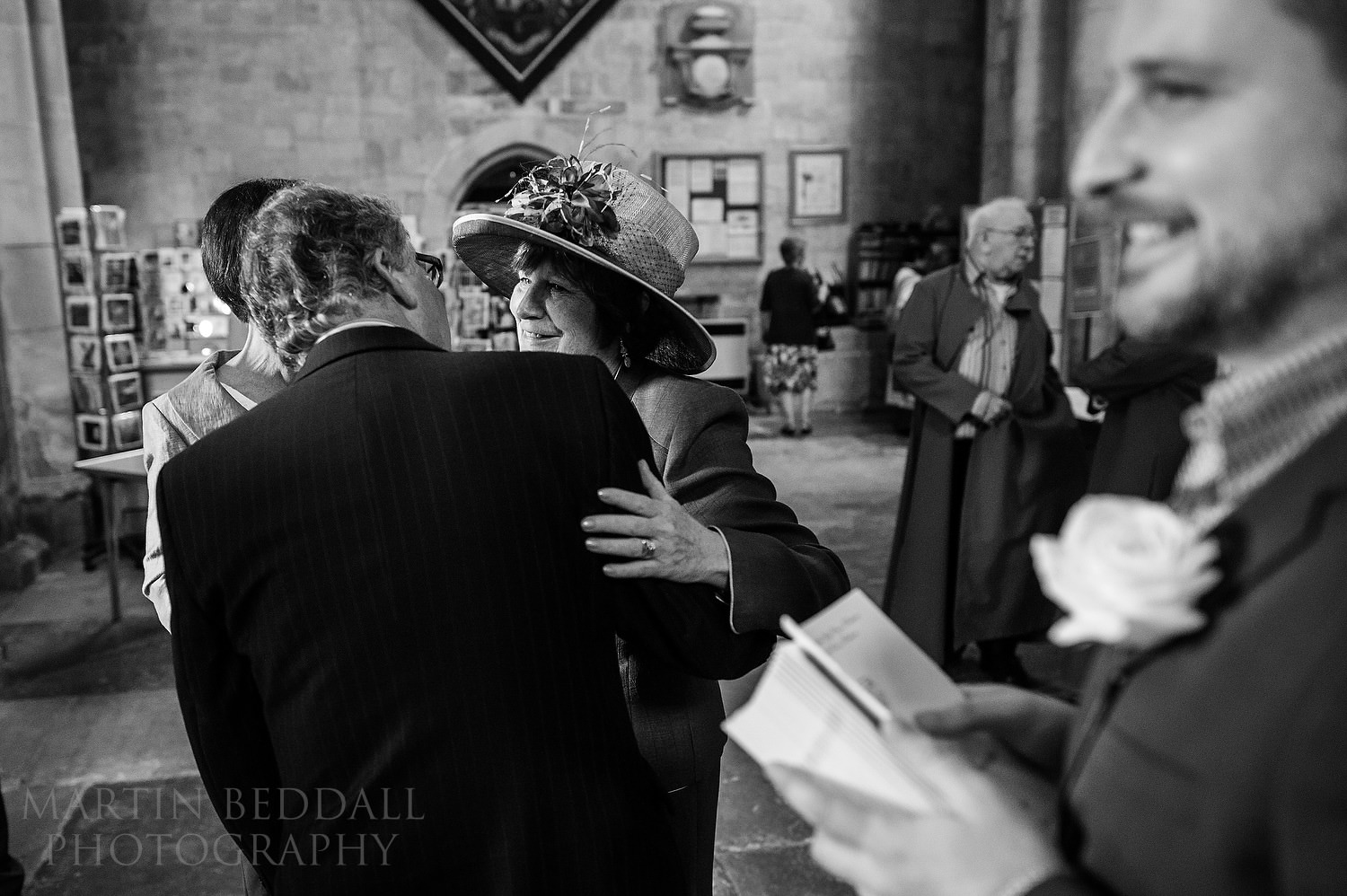 Greeting wedding guests in Pershore Abbey