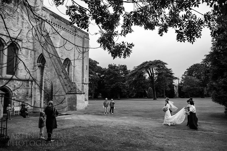 Bride walks towards Pershore Abbey