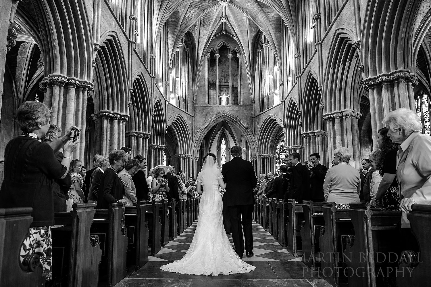 Bride and her father walk down the aisle at Pershore Abbey wedding