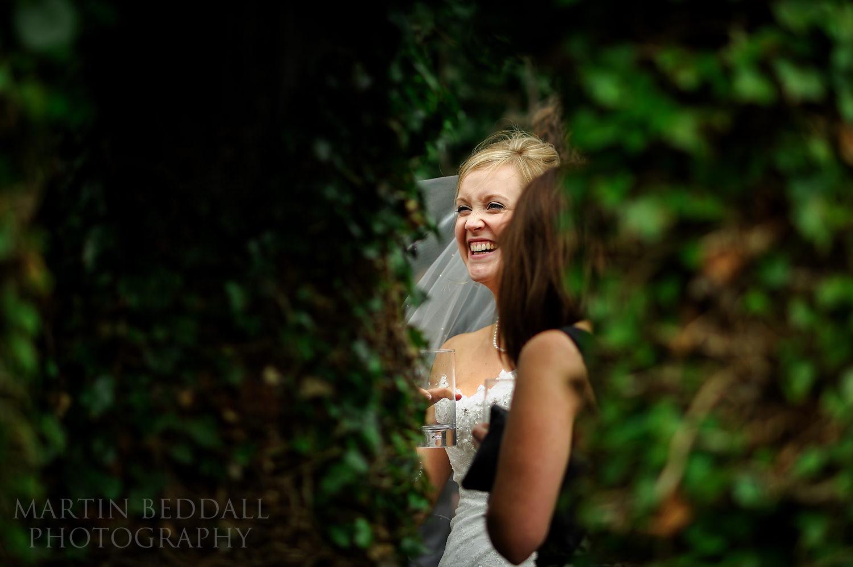 Laughing bride at Ridge Farm wedding reception