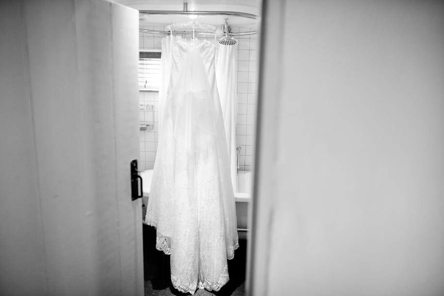 Wedding dress hanging in the bathroom