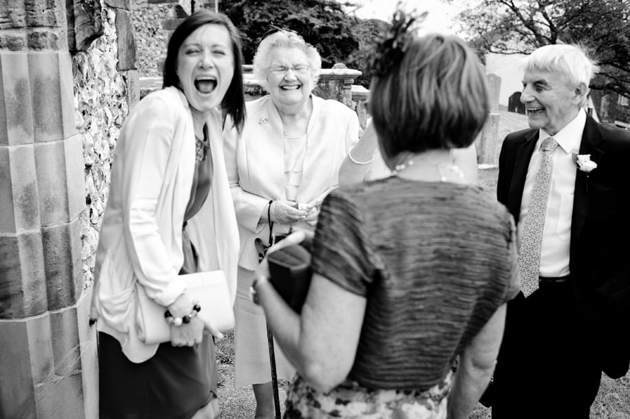 Family sharing a joke outside Ditchling church
