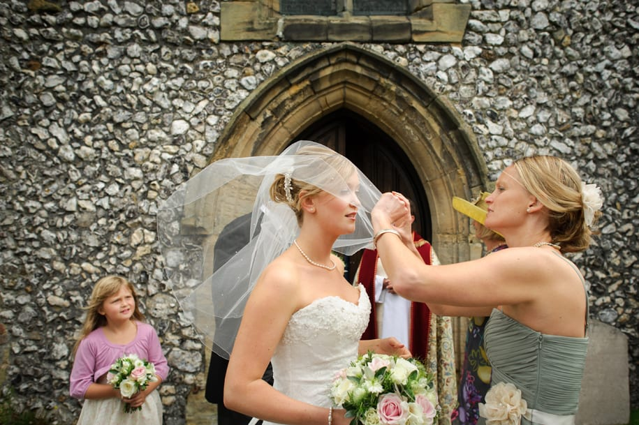 Final veil adjustments before entering Ditchling church