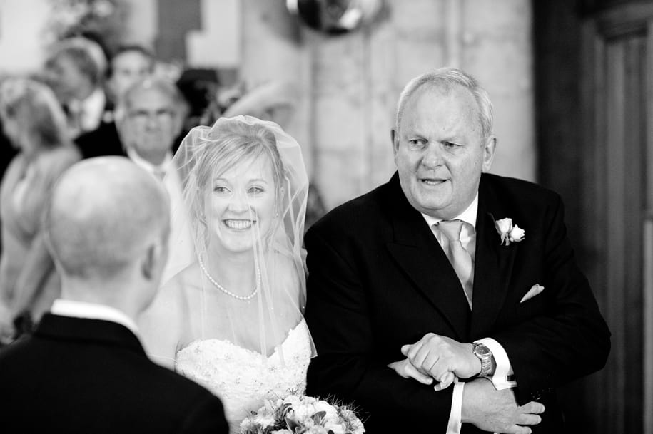 Bride and her father greet the groom at the altar.