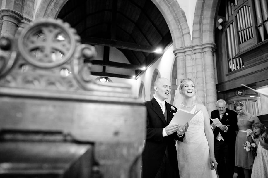 Sussex Wedding bride and groom sing hymns