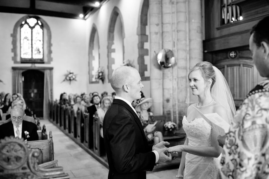 Groom puts the wedding ring on the bride's finger