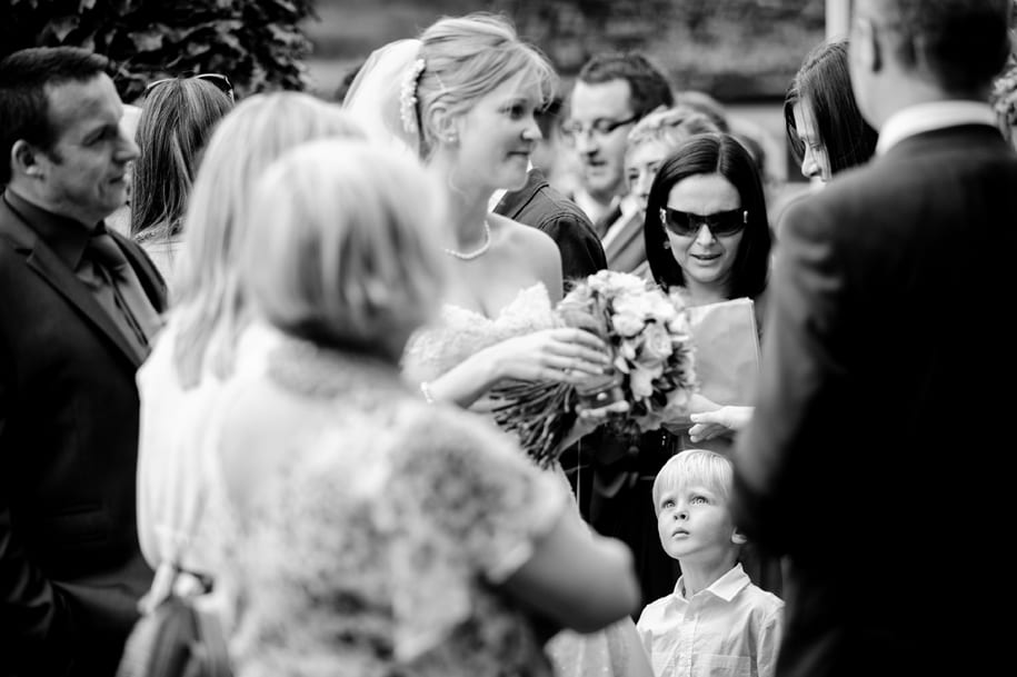 Young wedding guest looks on at ridge Farm