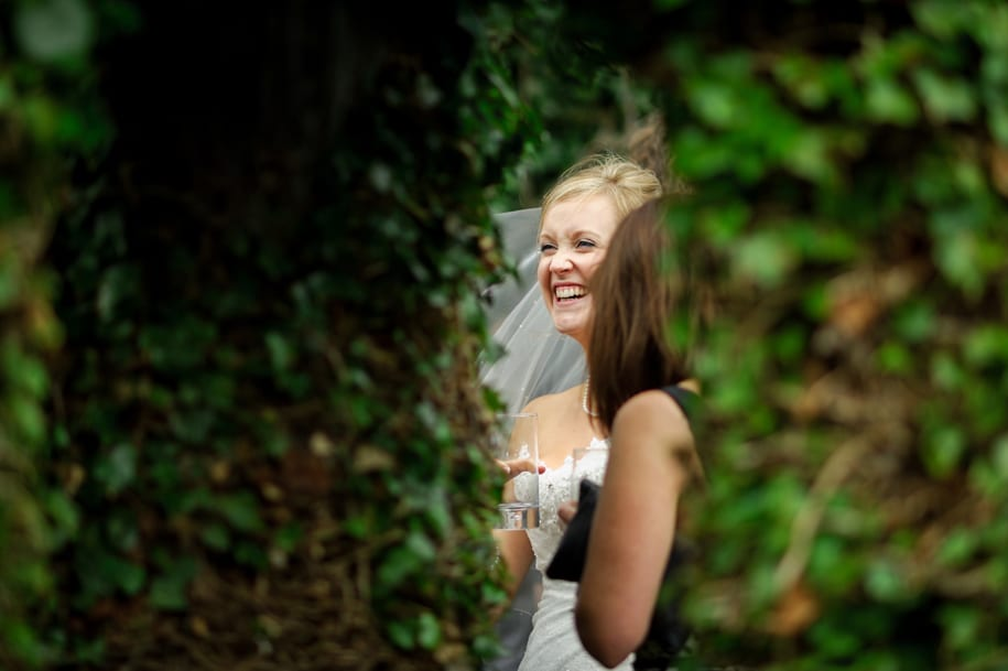 Bride laughing at her wedding reception