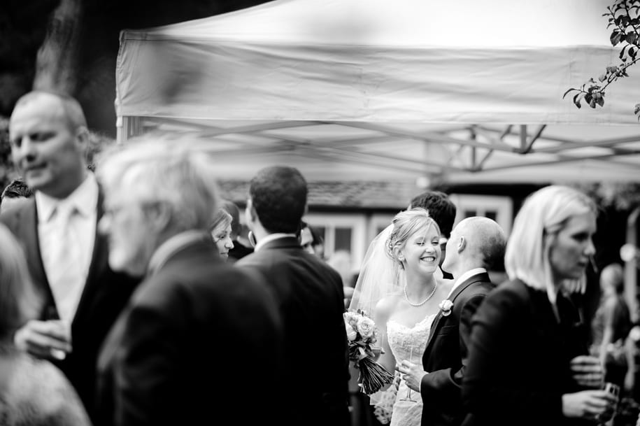 Bride and groom share a moment at their Ridge Farm wedding party