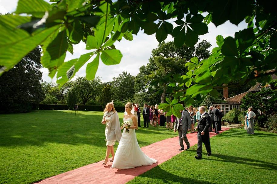 Wedding gusest walk towards the wedding meal