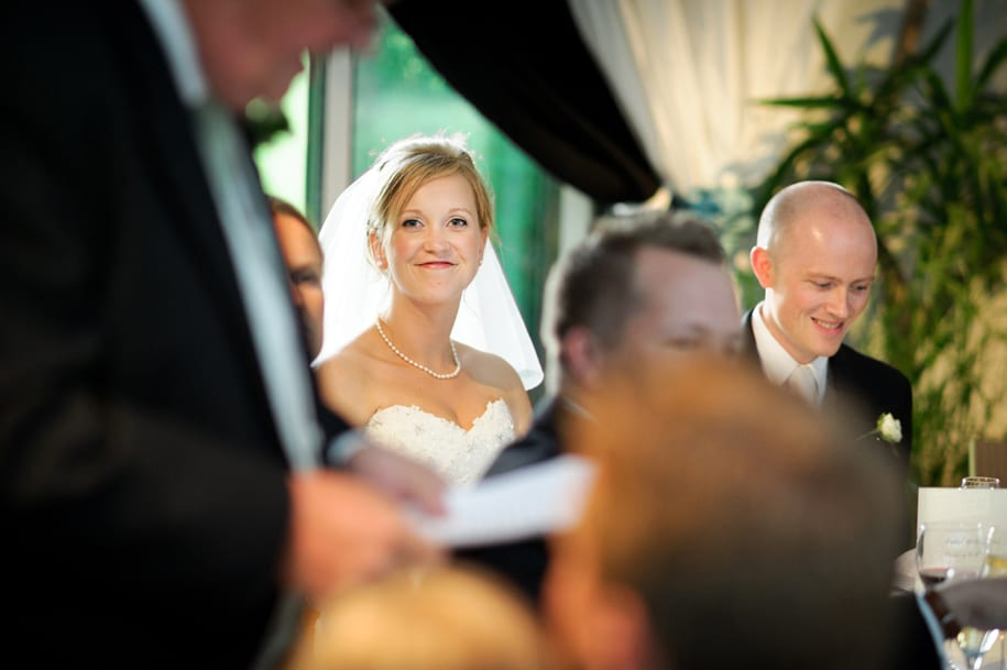 Bride watches her father's speech