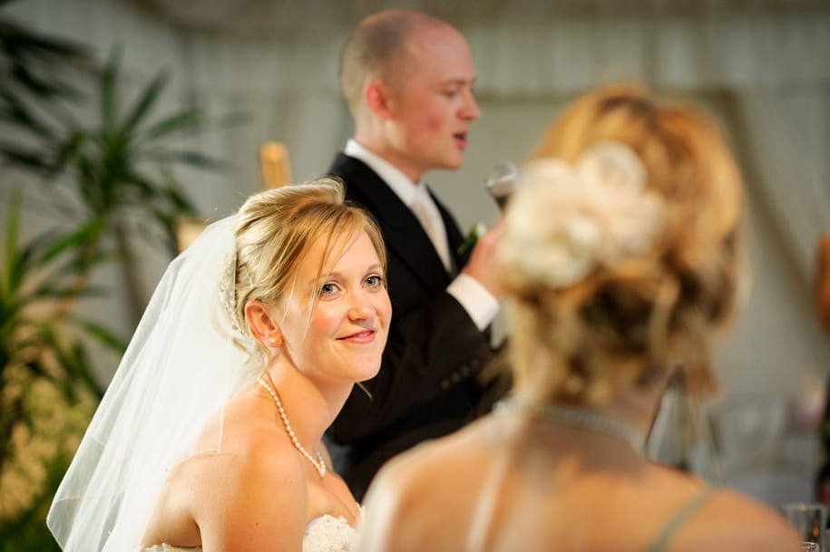 Bride looks at her sister during the speeches