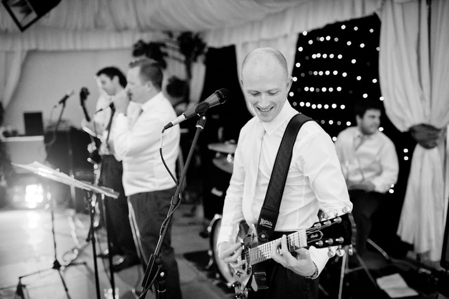 Groom plays in his band at the wedding reception