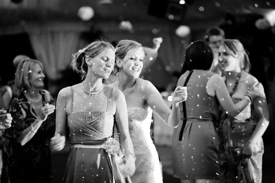 Bride and her sister dance at the wedding