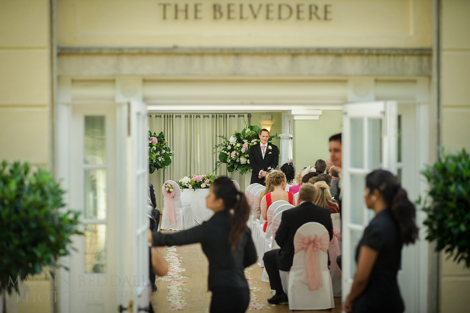 Groom waits at The Belvedere at Pembroke Lodge