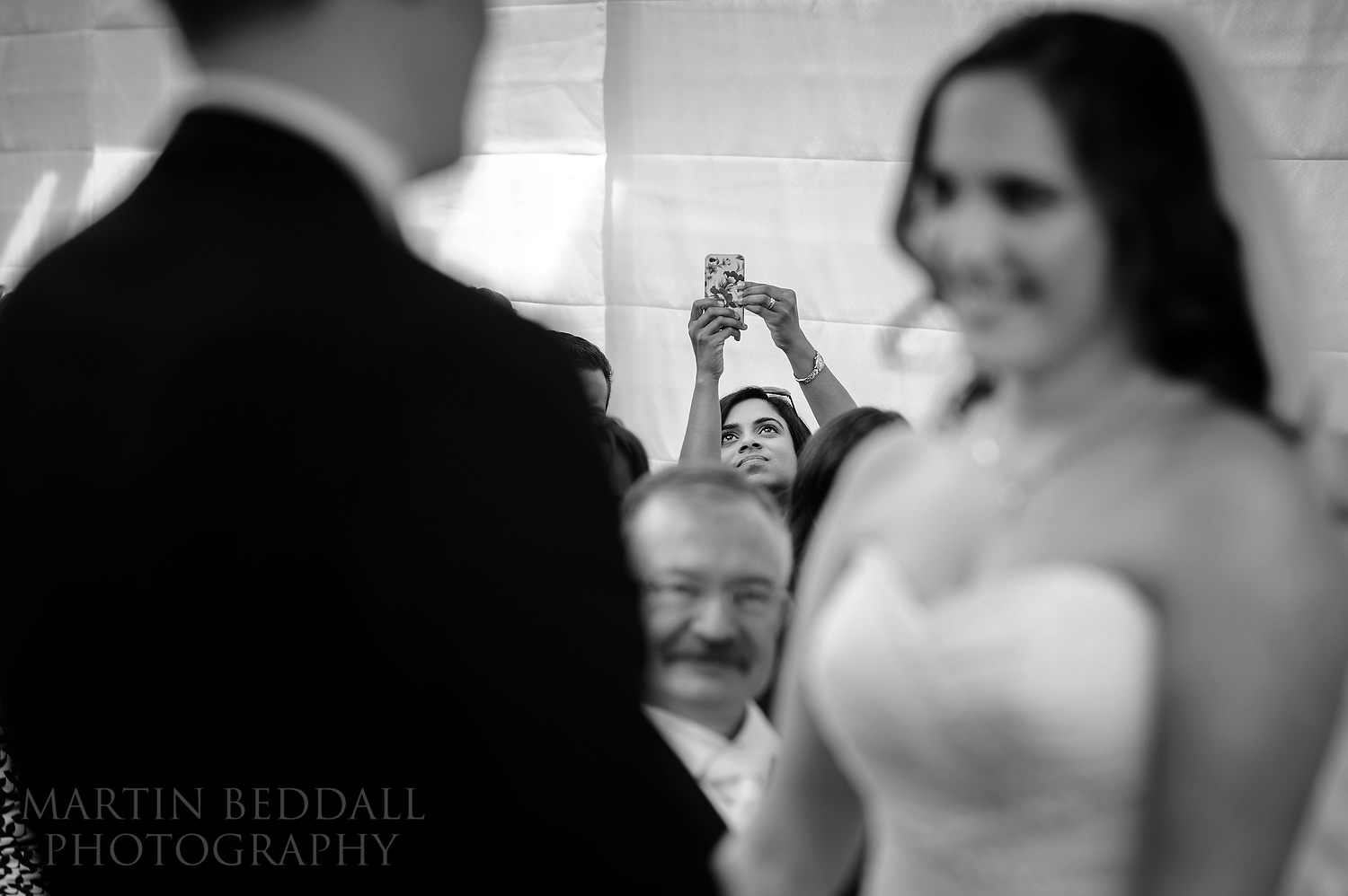 Wedding guest photographs the ceremony