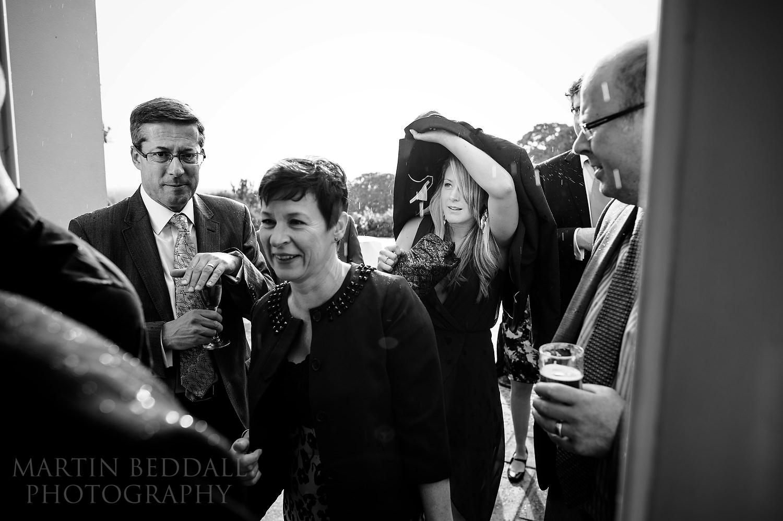 Rain interrupts the wedding reception