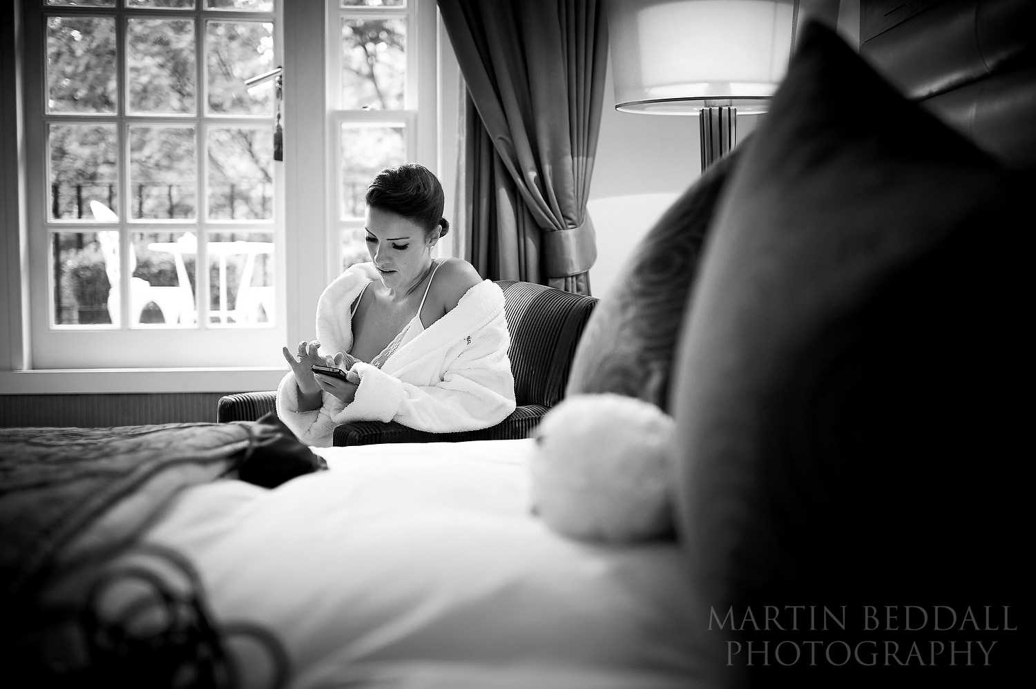 Quiet moment for the bride on her mobile phone