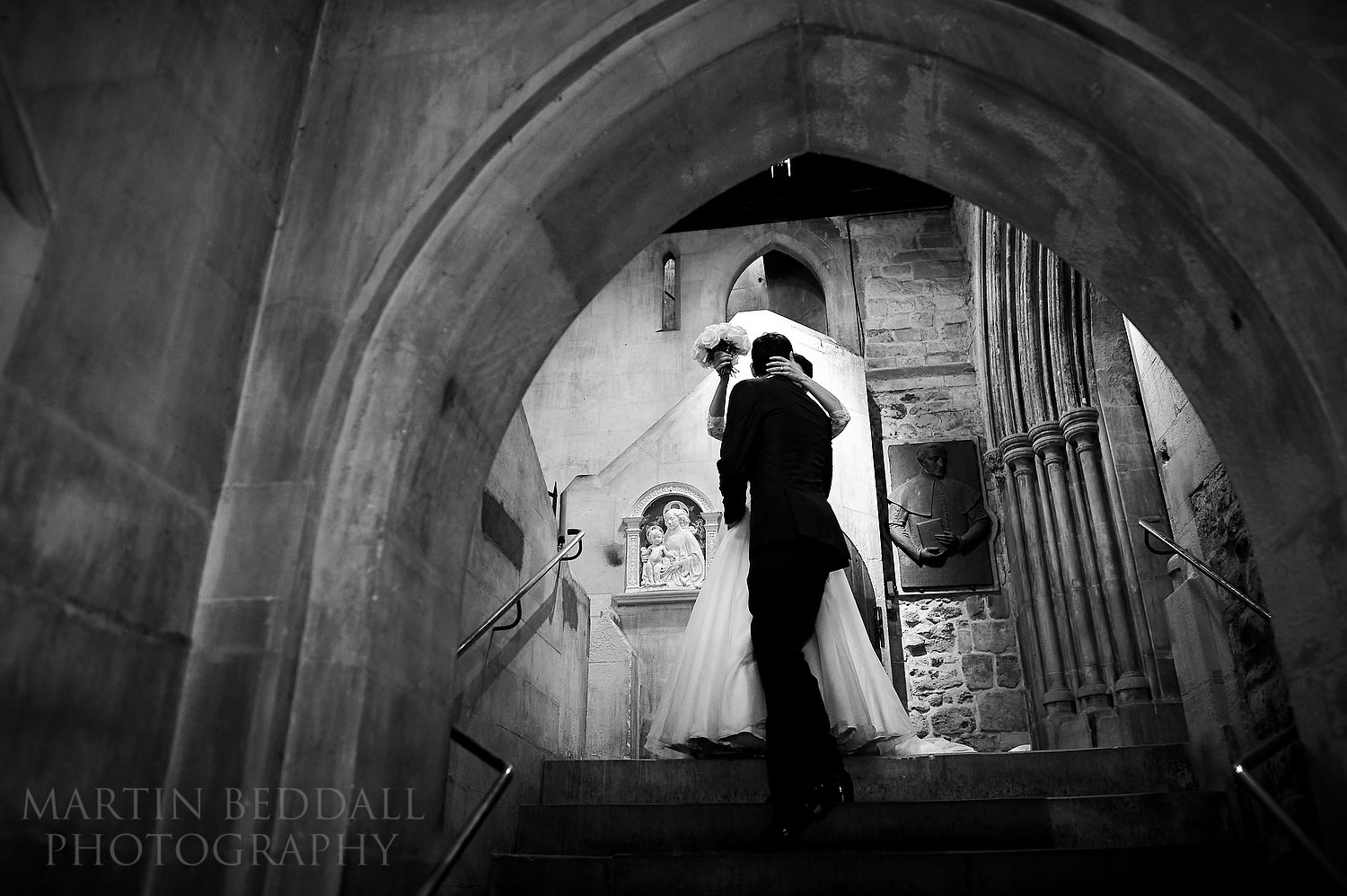 Bride and groom kiss after the ceremony at St Etheldreda's