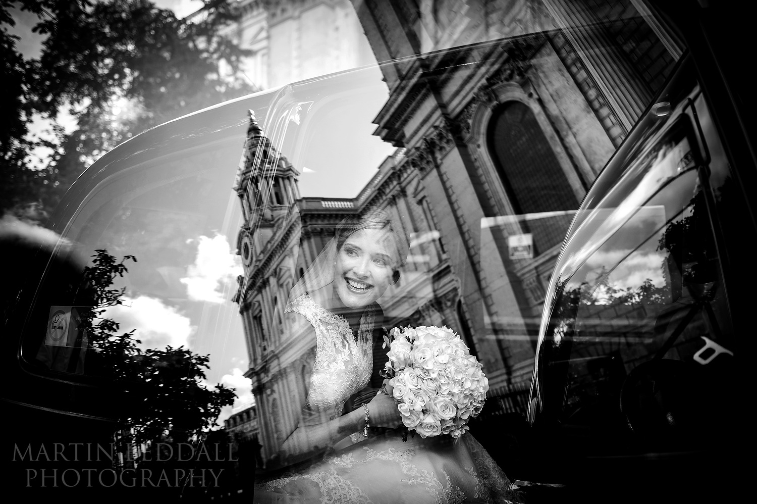 Bride in her London taxi outside St Paul's cathedral