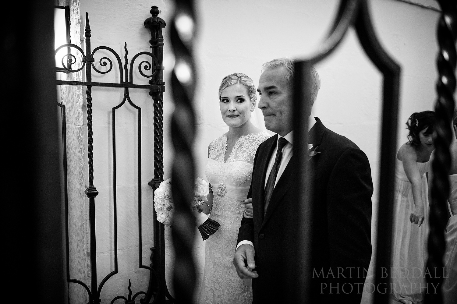 Bride looks to her father