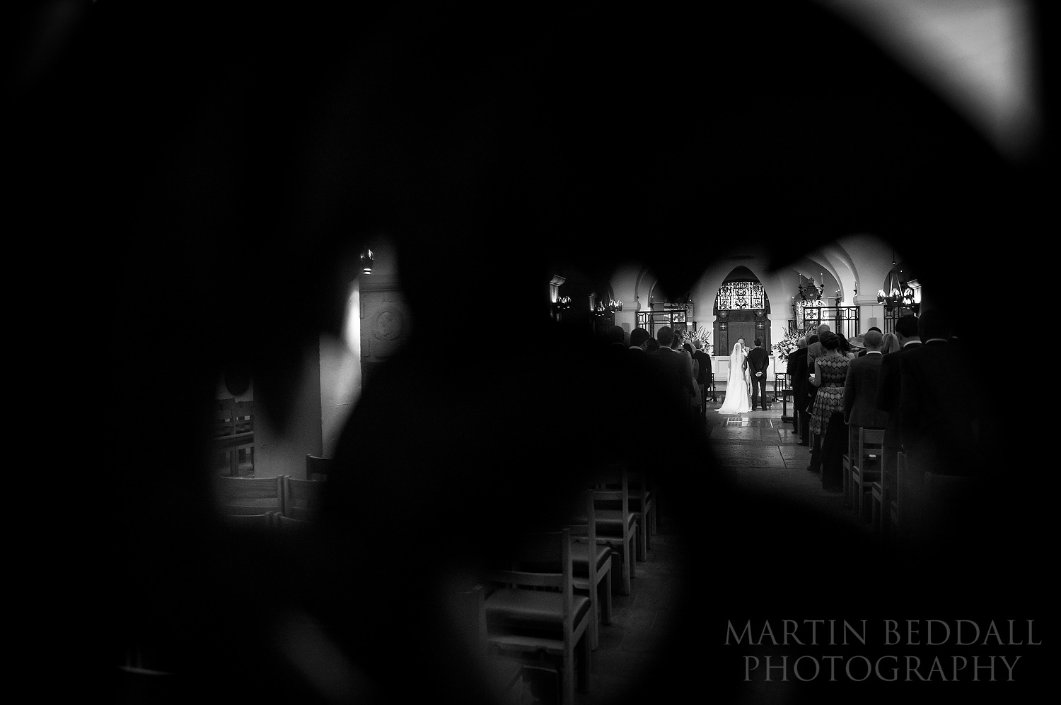 OBE Chapel wedding photography restricted to shooting through small holes in chapel door