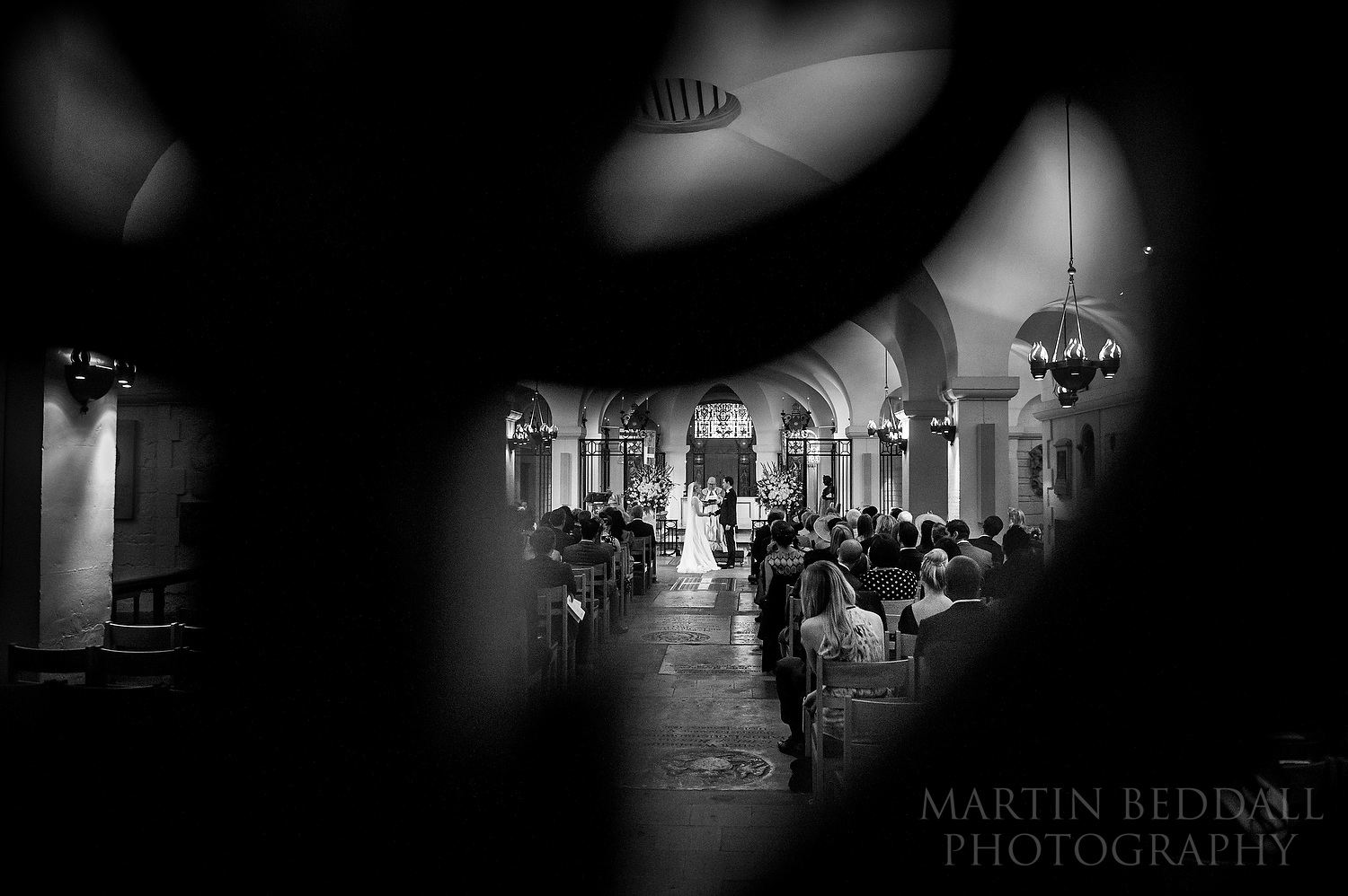 OBE Chapel wedding photography restricted to shooting through small holes in chapel door as no access allowed