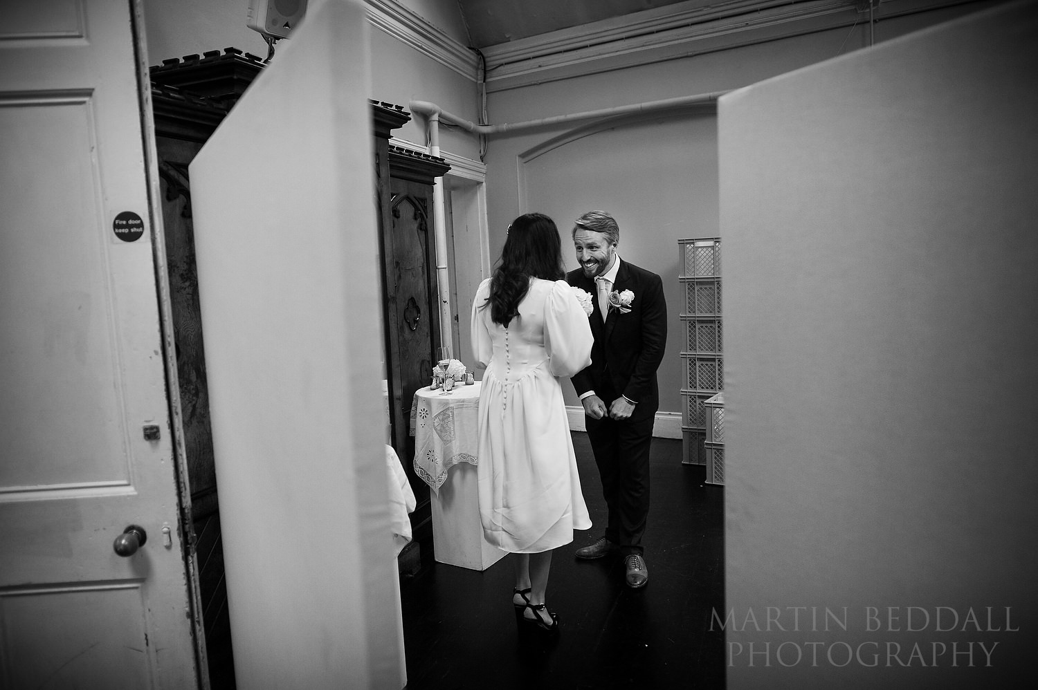 Bride and groom wait to be announced into dinner