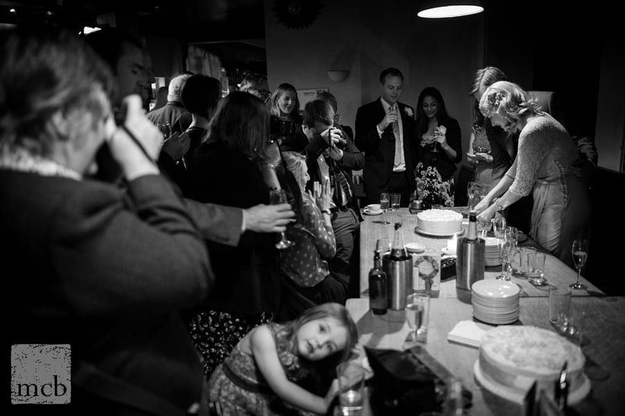 Couple cut the cake at Duke of Cambridge pub Islington wedding reception