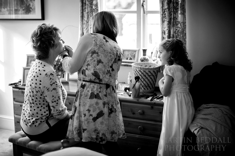 Flower girl watches makeup