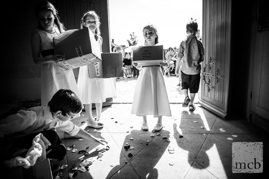 Children wait to shower the bride and groom in confetti