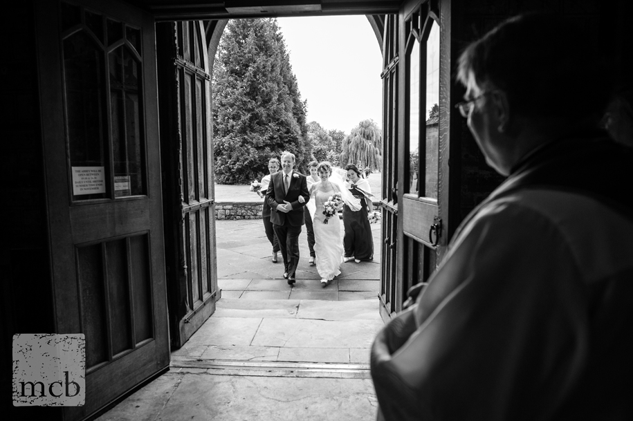 Bride arrives at Pershore Abbey