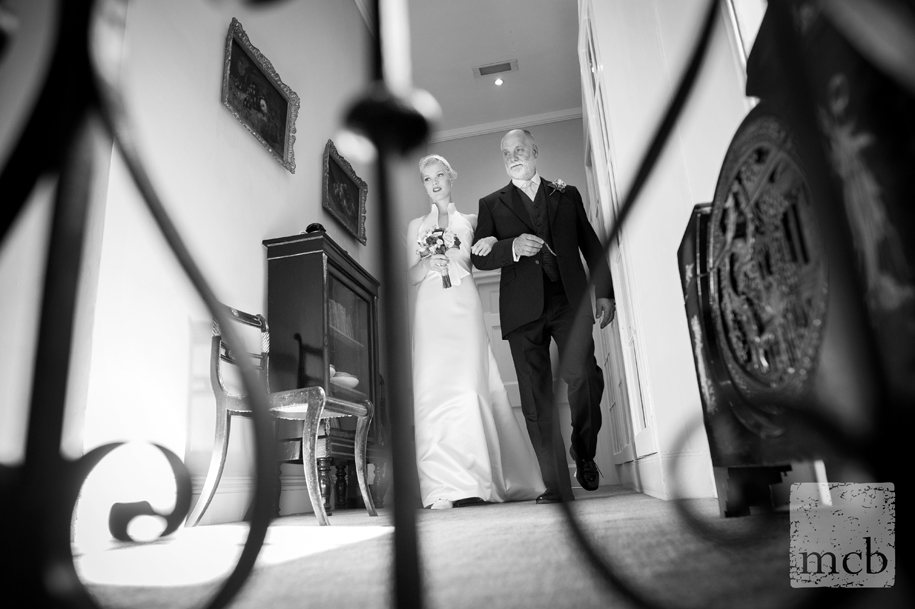 Bride is escorted from her room by her father