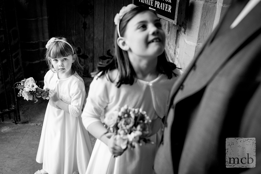 The flowergirls wait for the bride in the porch of St Mary's church in Horsham