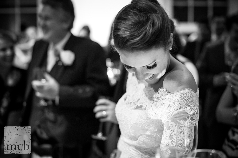 Beautiful bride looks down laughing