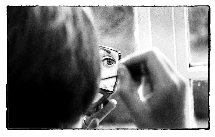 Close up of bride's eye reflected in mirror, shot on film