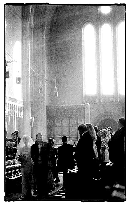 Bride and her father walk down Charterhouse school chapel aisle