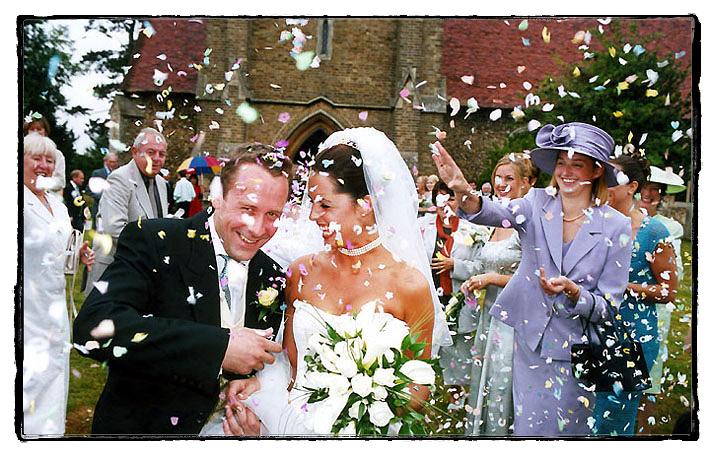 Couple excit church to loads of confetti