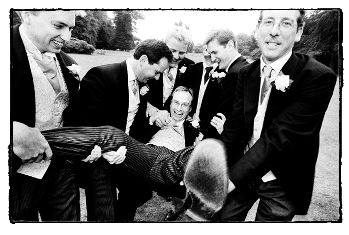 Groom is manhandled by his ushers