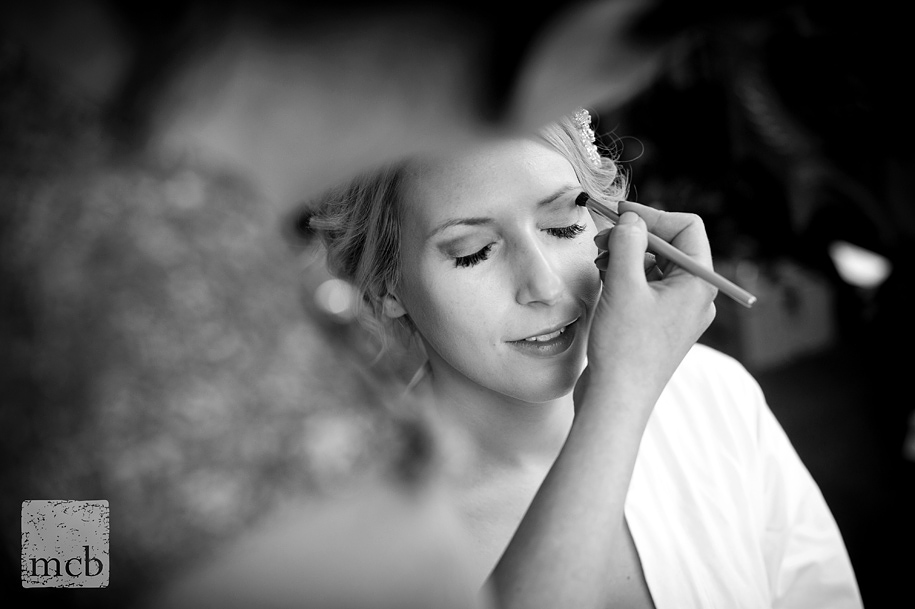 Bride has her makeup done at Braxted Park