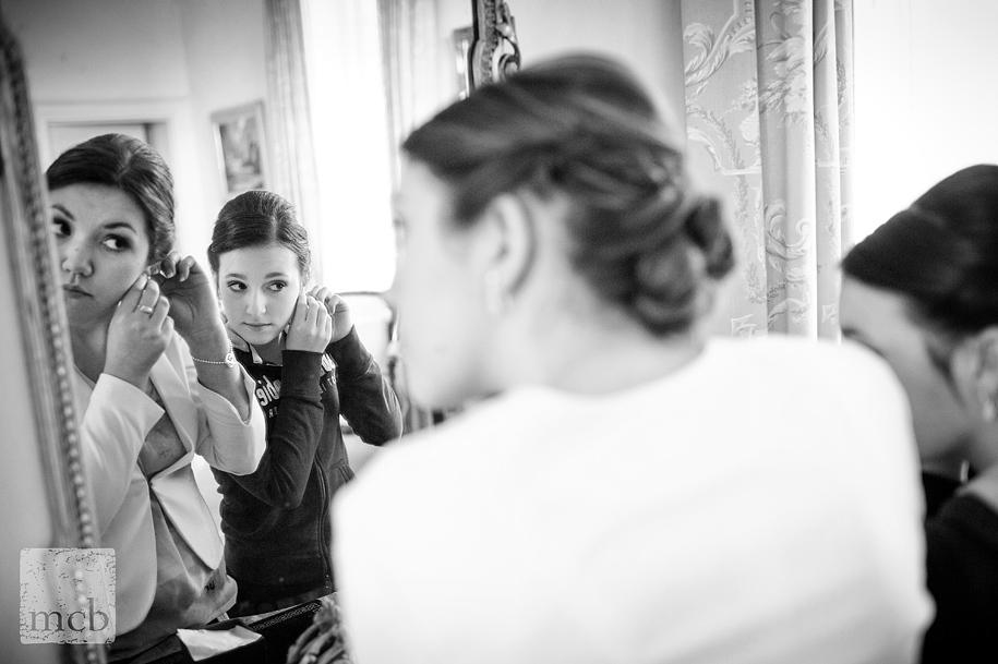 Bridesmaids share a mirror