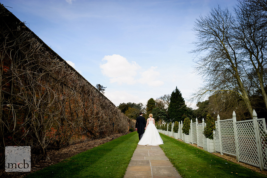Bride and groom walk hand in hand at Braxted Park