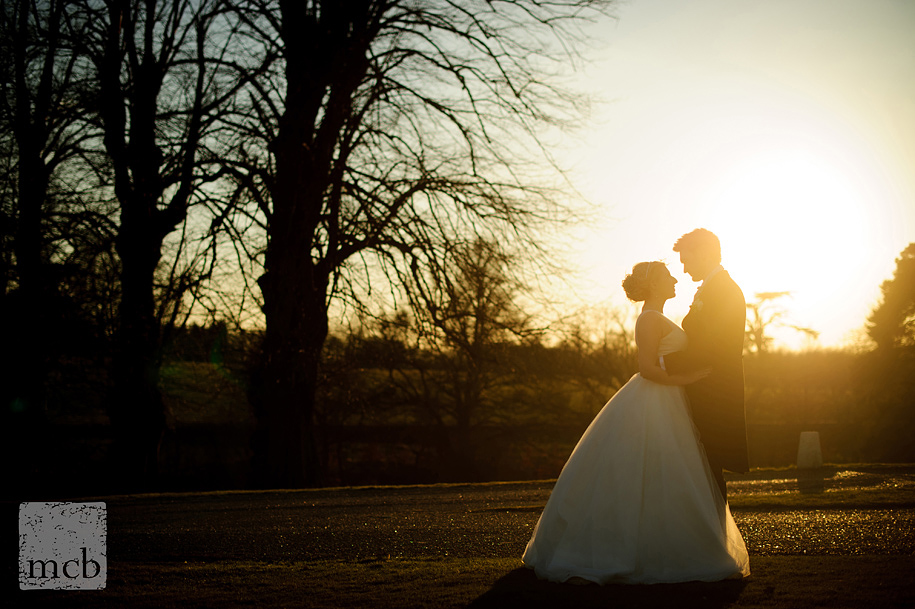 Sunset portrait of bride and groom at Braxted Park