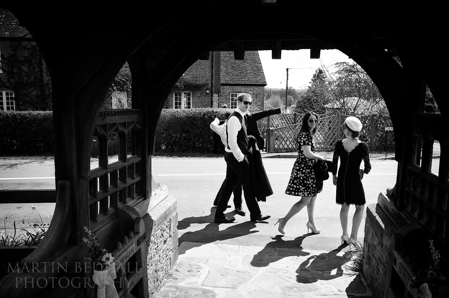 Wedding guests hread to the pub opposite Newdigate church