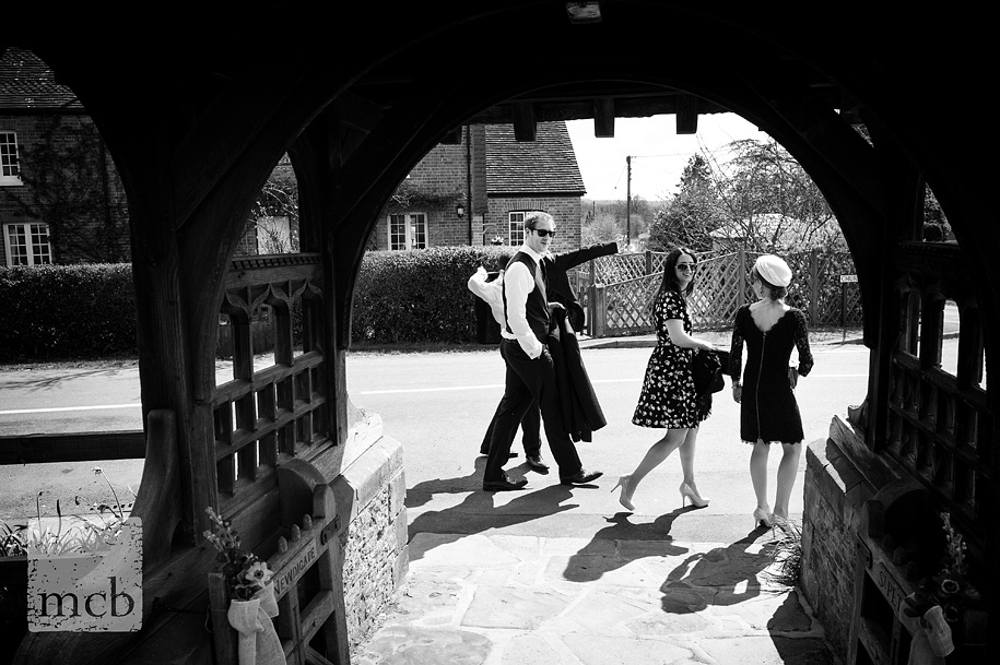 Wedding guests walk past St Peters church in Newdigate