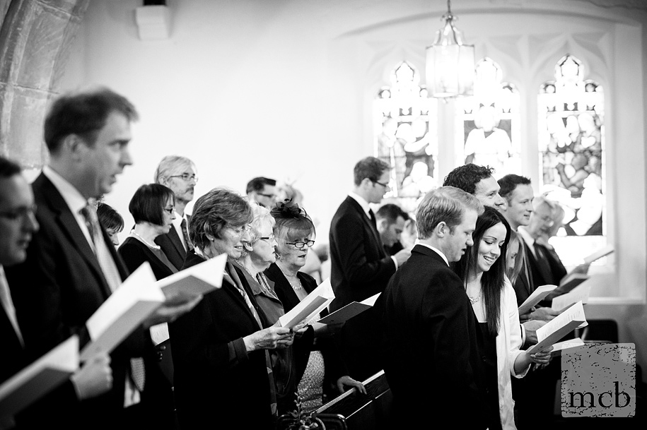 Wedding guests singing at Newdigate church