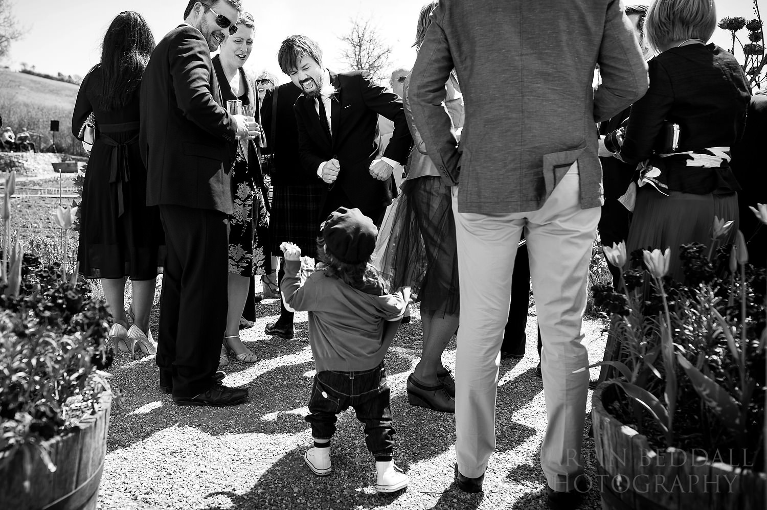 groom and his young son