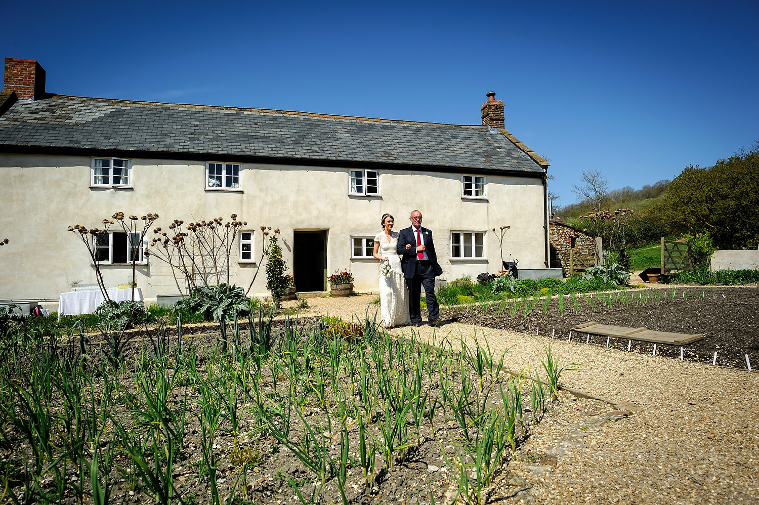 Bride and her father walk out of River Cottage
